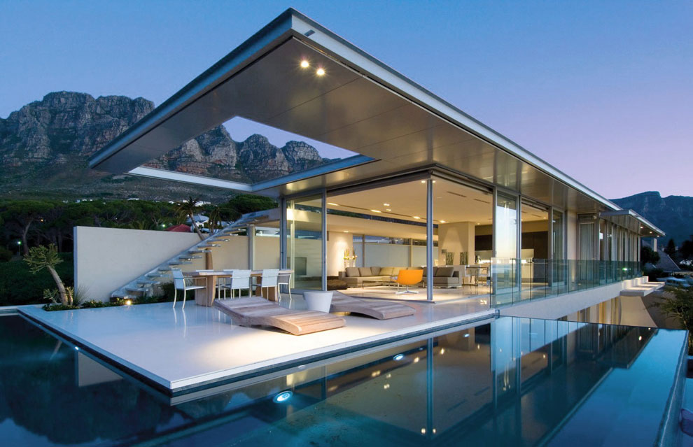 30 foto di piscine stupende dal design moderno for Modern house plans with swimming pool