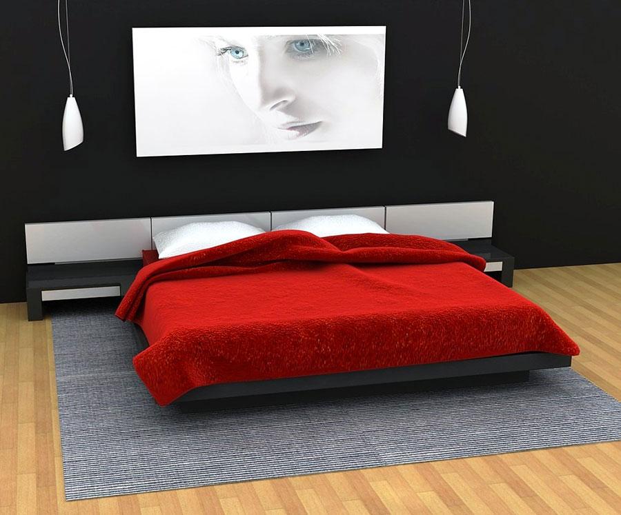 Camera da letto arredata con le tonalità rosso e grigio n.12