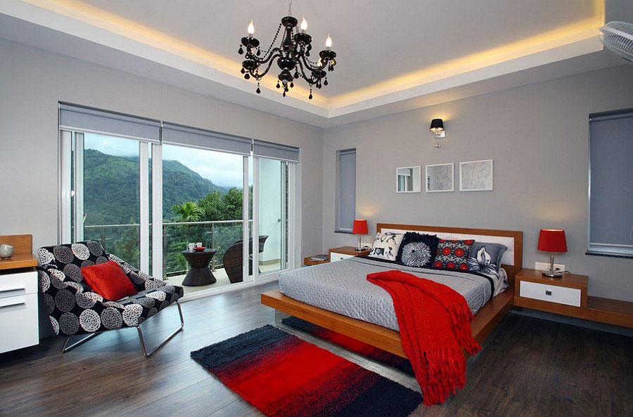 Camera da letto arredata con le tonalità rosso e grigio n.13