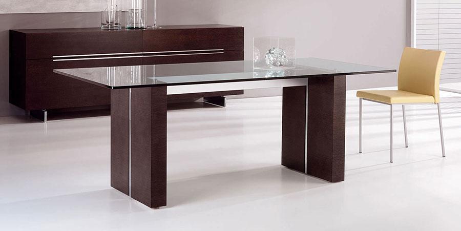 Modello di tavolo in vetro allungabile dal design moderno n.16