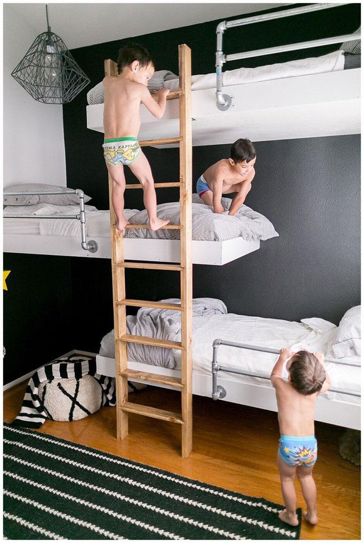 Idee di arredo per camerette dei bambini con tre letti n.11