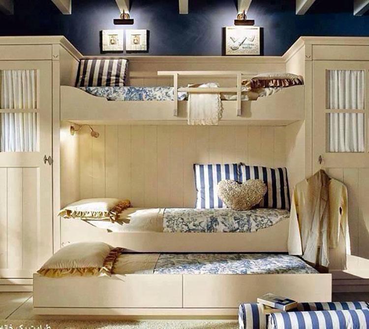 Idee di arredo per camerette dei bambini con tre letti n.21