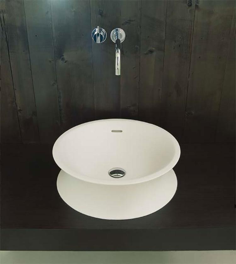 Modello di lavabo bagno in pietra da appoggio originale n.25