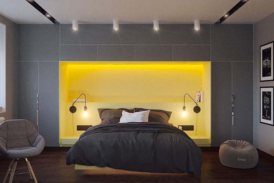 Colori grigio e giallo per la camera da letto