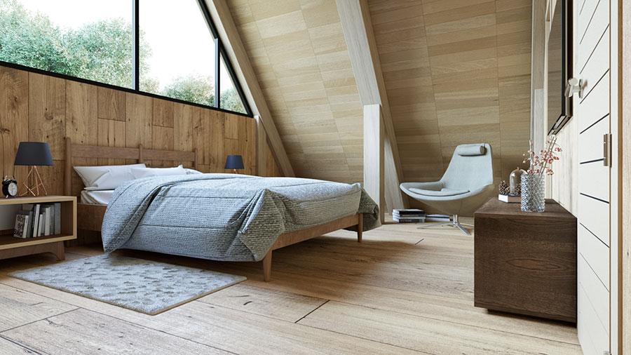 Idee per arredare una camera da letto in legno in mansarda n.01