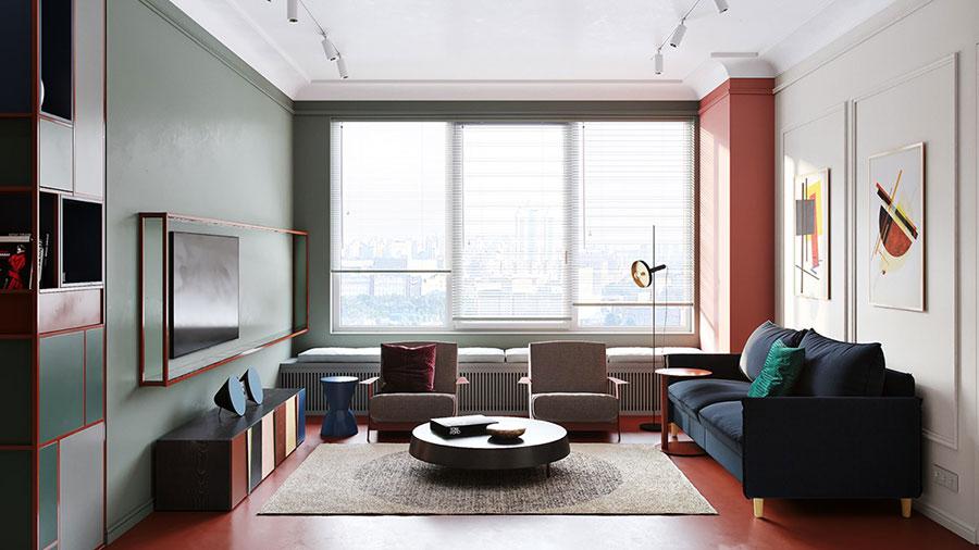 Casa con arredamento vintage nelle tonalità del rosso, blu e verde n.1