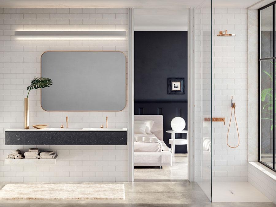 Idee per arredare un bagno bianco e grigio n.02