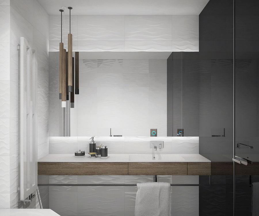 Idee per arredare un bagno bianco e grigio n.13