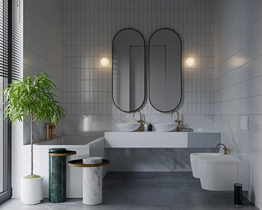 Idee per arredare un bagno bianco e grigio n.24