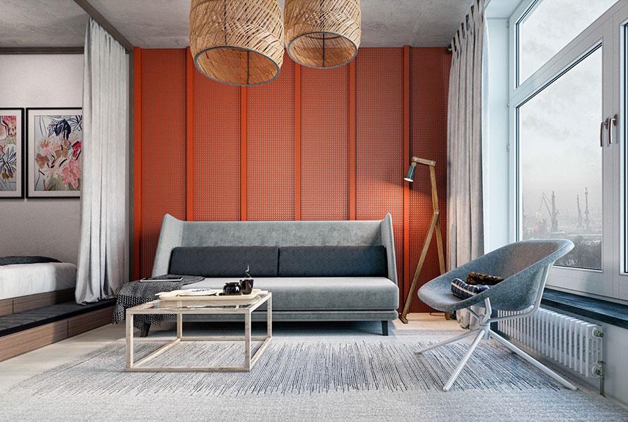 Idee per arredare un salotto con pareti e accessori rossi n.07