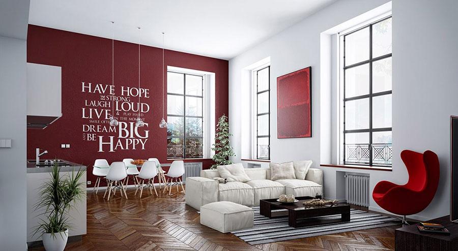 Idee per arredare un salotto con pareti e accessori rossi n.20