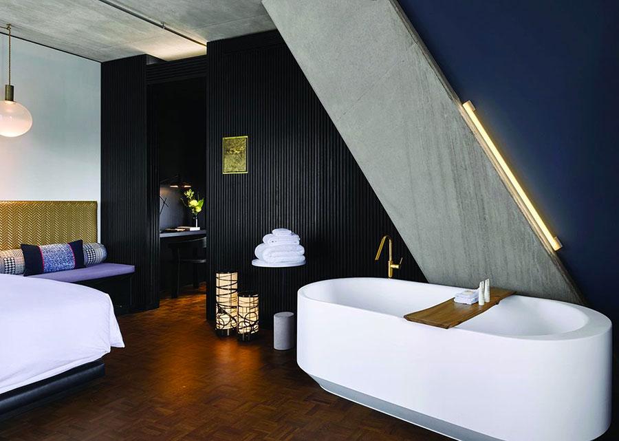 Idee per inserire una vasca da bagna in una camera da letto moderna n.06