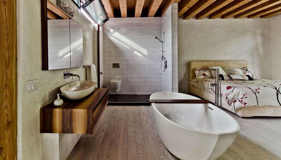 Idee per inserire una vasca da bagna in una camera da letto moderna n.12