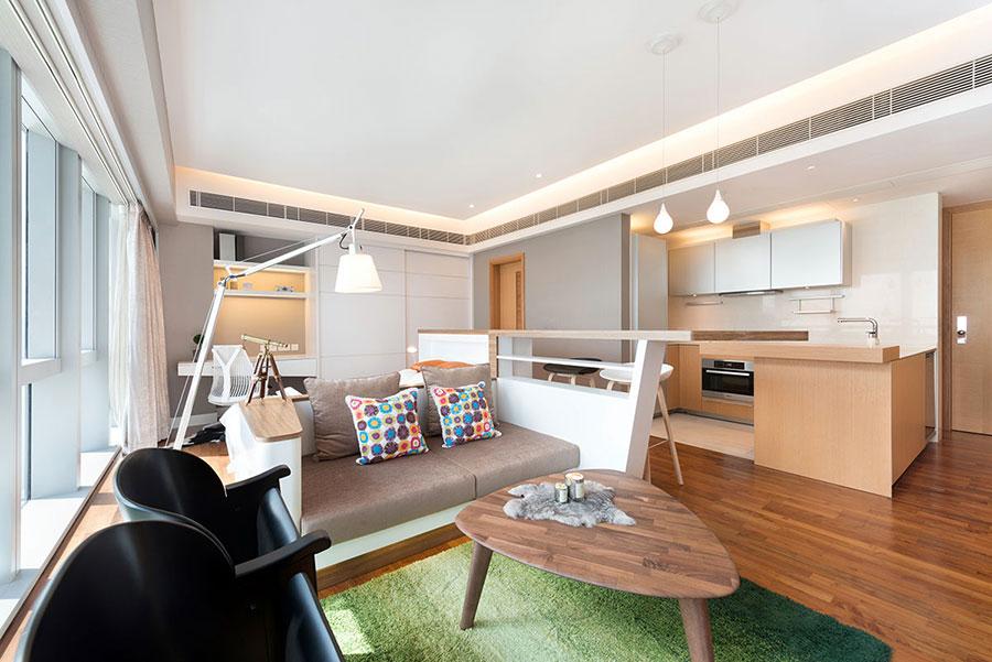 Idee per un soggiorno con angolo cottura n.15