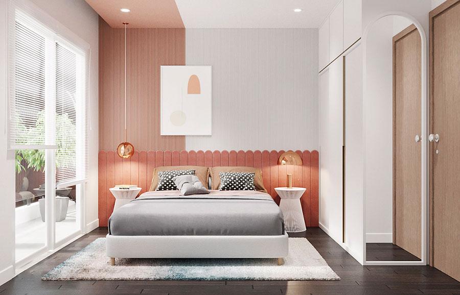 Idee per arredare una camera da letto rosa antico e grigio n.09