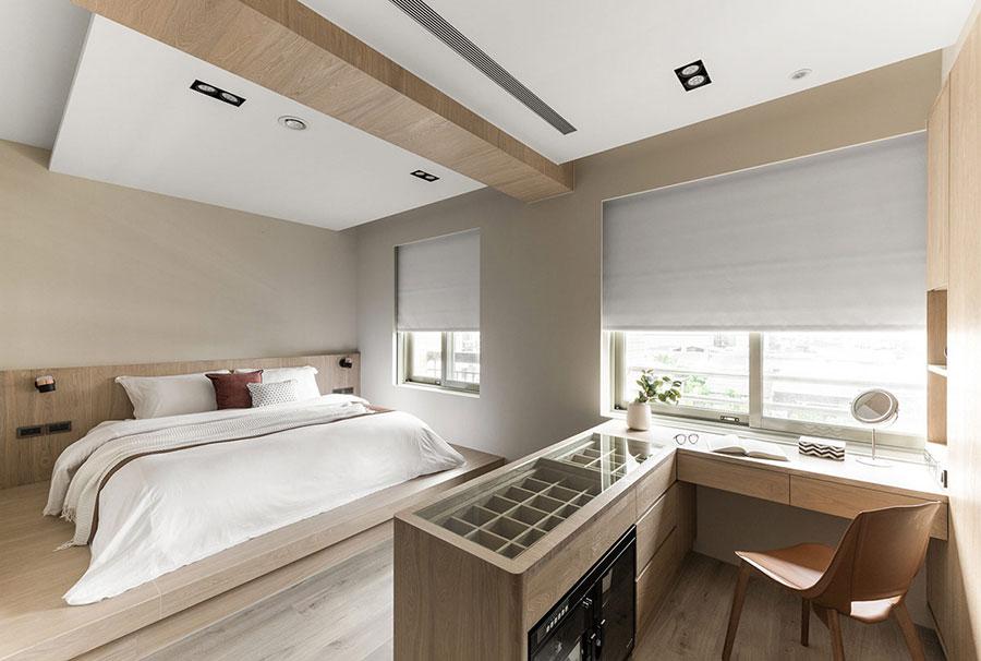 Idee per arredare una camera da letto bianca e legno n.18