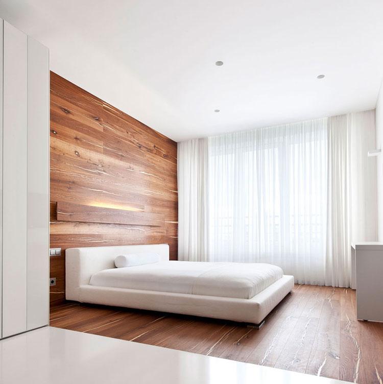 Idee per arredare una camera da letto bianca e legno n.19