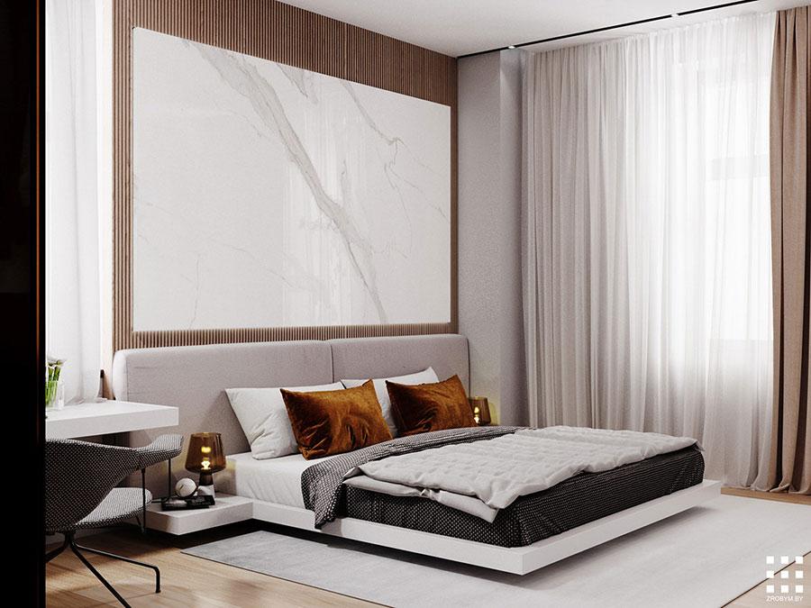 Idee per arredare una camera da letto bianca e legno n.23