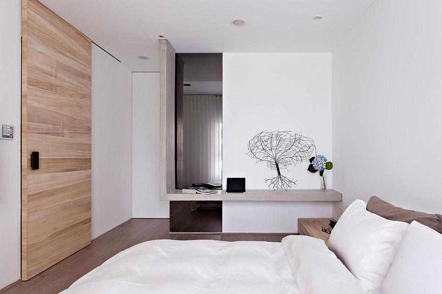 Idee per arredare una camera da letto bianca e legno n.24