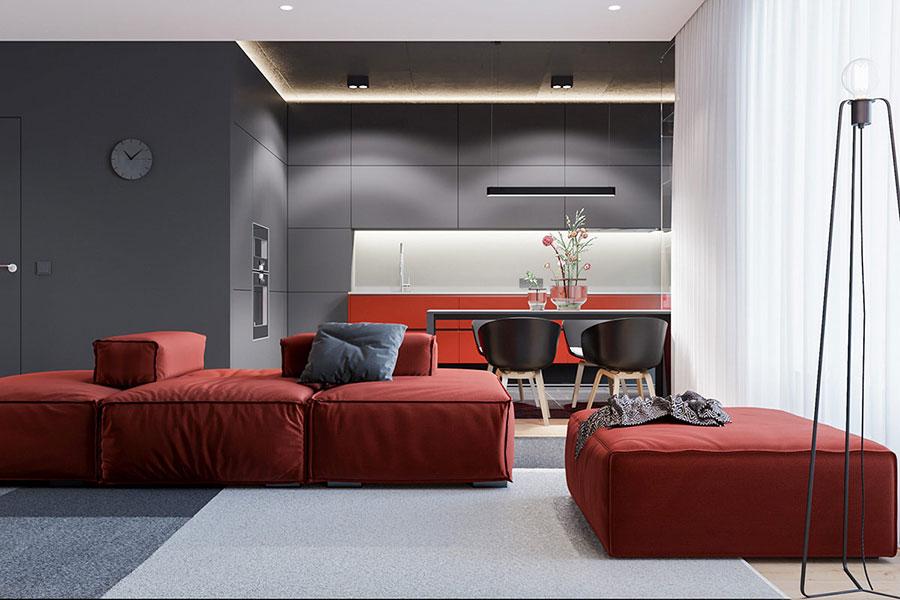 Idee per abbinare il divano rosso alle pareti grigie n.02